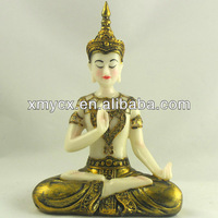 Tabletop decorative buddha figure in marble look.