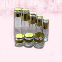 packaging cosmetics lotion/serum bottles 120ml clear glass essence bottle with golden luxury screw cover wholesale