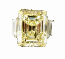 GIA CERTIFIED FANCY LIGHT YELLOW DIAMOND DIAMOND TWO STEP CUT TRAPEZOID RING