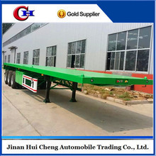 Factory price tri-axle 60 ton 40ft flatbed truck trailer / container semi-trailer with twist lock