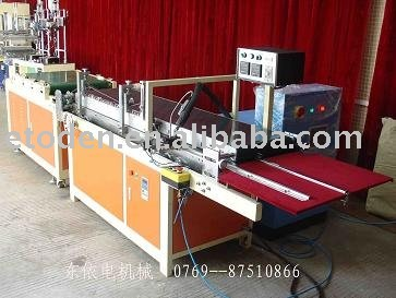adhering machine