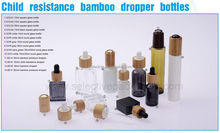 child resistance bamboo dropper bottles round glass bottle 15ml 30ml square childproof dropper bottle for smoke oil