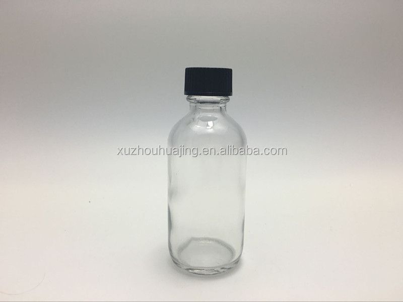 cheap 2oz 60ml clear boston round glass bottle with bakalite cap wholesale
