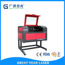 Mini CO2 laser cutting and engraving machine leather, wood, acrylic laser cutter price