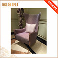 Comfortable Wing Back Brass and Fabric Upholstered Combined Lounge Chair with Rose Gold Plated Goat Legs