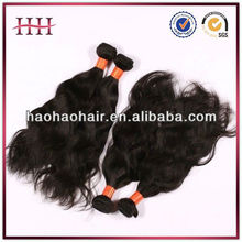 Quality human hair natural black 8-30 inches malaysian curly wavy hair,5a grade unprocessed natural malaysian virgin hair wavy