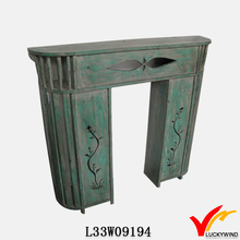 distressed green burning hand carved wood mantels