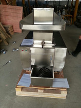 Bone grinder for beef bone processing