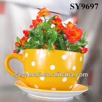Ceramic yellow tea cup and saucer flower pot