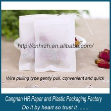 Empty filter paper for tea bag with string and tag