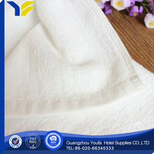 bleached Guangzhou 100% organic cotton closeout towels low price