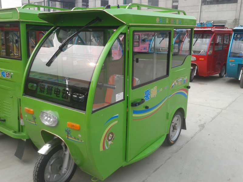 green color mini 2 door electric tricycle