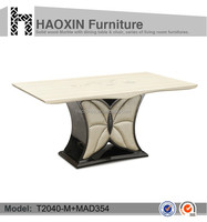 Elegant dining table wooden base and marble top