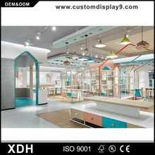 Customized wooden clothes display cabinet for retail clothing store kiosk