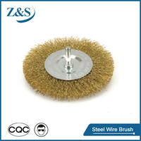 Crimped wire wheel brushes with shaft mounted