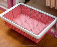 pretty pink small rattan basket with compartment for girl bed room.