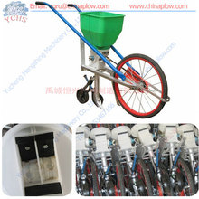Corn hand seeder with fertilizer