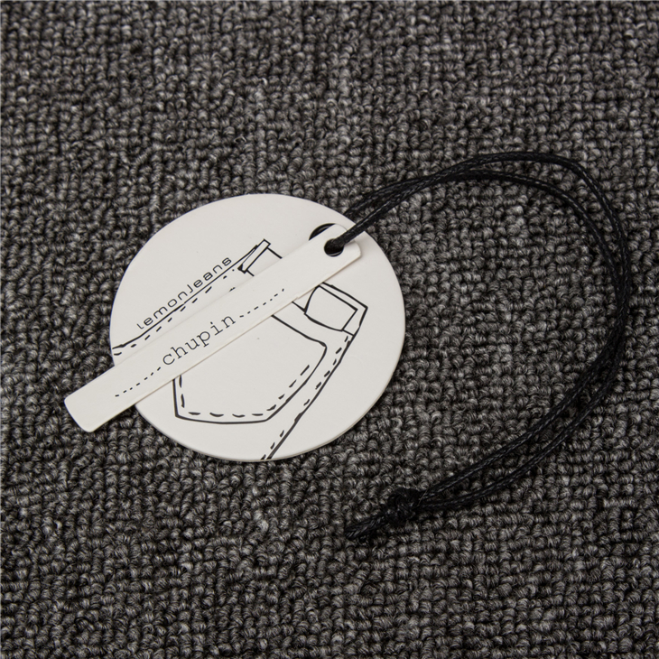 Eyelet and Wax Rope clothing tag design with string