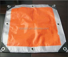 orange/silver tarpaulin sheet