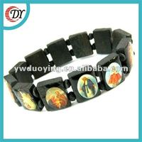 wooden bracelet with holy pictures