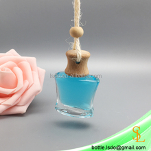 X shaped nice curve portable 11ml hanging car air freshener glass diffuser bottle for perfume with wood cap and rope