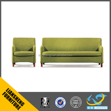 Hot sale Green fabric visitor treating sofa with solid wooden base