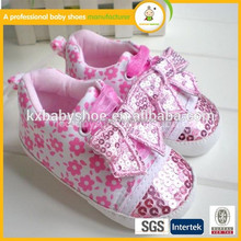 The latest handmade beads ribbon soft bottom baby shoes,Top selling lovely pink prewalker shoes