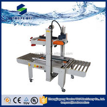 Automatic pick and place case packer for PET bottles