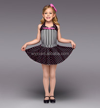 halter leotard , black and white striped bodice, a black and hot pink polka dot skirt- dancing wear