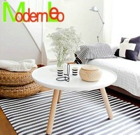 white round wooden coffee table