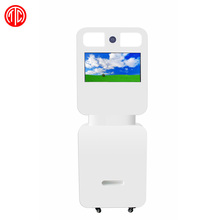 White kiosk stands touch screen photo booth or black