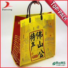China handy customized clothes packaging handle plastic bag
