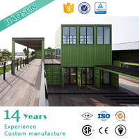 green prefabricated container house in farm or construction site for temporary living or halfway break