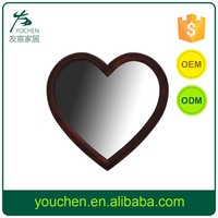 Heart shaped wooden framed wall mirror