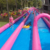 Big popular commercial event inflatable water slide through the city , pink slide the city for adult and kids