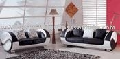 Contemporary Black Leather w/Silver Backwall Sofa and Loveseat Set