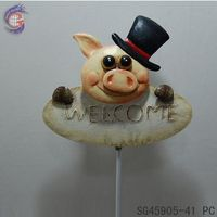 pig iron stake decor in garden with welcome sign