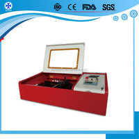 mini laser stamp making machine/Laser engraver for Mat Board, Melamine, Paper with manufacturer of laser machine For Sale