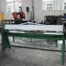 Self supporting top beam for safety hand folder machine