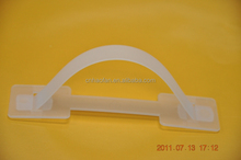Plastic handles for corrugated boxes