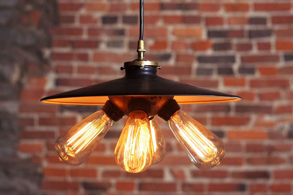 Industrial pendant lamp with metal shade and socket cluster. Lamp is UL listed