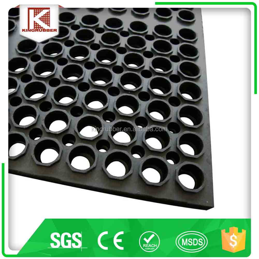 industrial anti fatigue rubber floor mat with large holes to allow liquids and debris to fall through