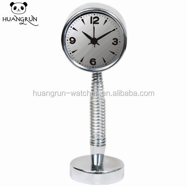 Spring type metal table clock