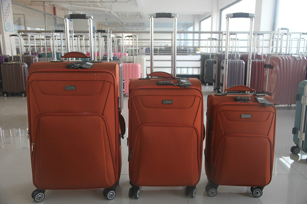 New luggage/World top 500 ODM factory/High quality spinner luggage20/24/28 inch 3pcs four wheels soft luggage sets