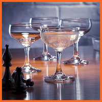 Hand made high quality transparent glass champagne coupe with long stem