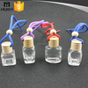 empty bottle car air freshener hanging with woden cap and string