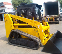 NEWLAND brand W7100T crawler loader with backhoe attachment