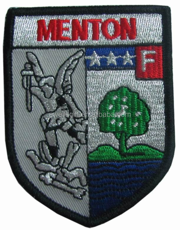 Metion - Wood Mounted and fly man embroidery patch