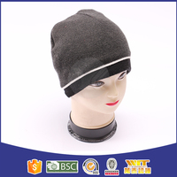 Promotional low price plain knitted embroidery custom beanie with woven label