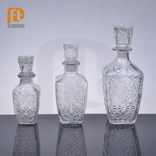 2016 New Product Empty Vodka Glass Bottle Embossed Decorative Glass Square Whiskey Decanter with Airtight Stopper